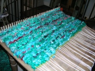 Peg loom and dyed wool