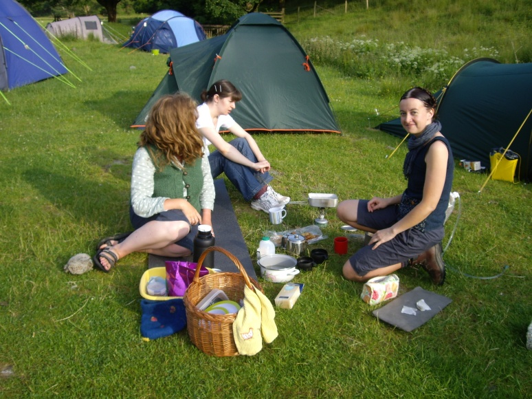 Lara Clements, Liz Ashdowne and Kate Davies camping at Buttermere in 2009, discussing WOOL after WOOLFEST. I am behind the camera.