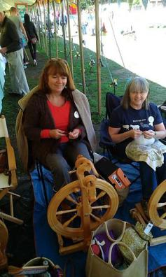 Sue Routledge and Karen Ashley spinning at Sutton on Trent festival